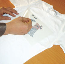 Remove protective plastic backing from transfer.
